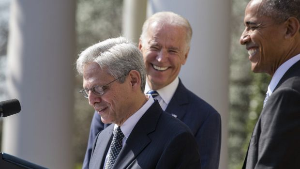 US President Barack Obama, right, and Vice President Joseph Biden, centre, laugh as Merrick Garland, chief judge of the ...