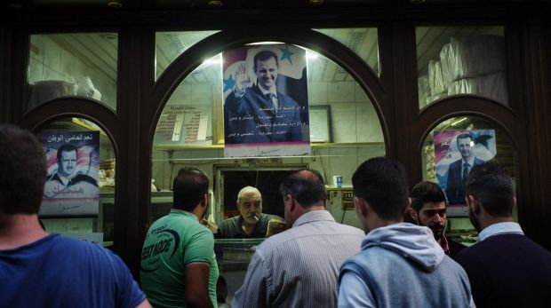 An image of Syrian president Bashar Assad hangs in a business in old city of Damascus.