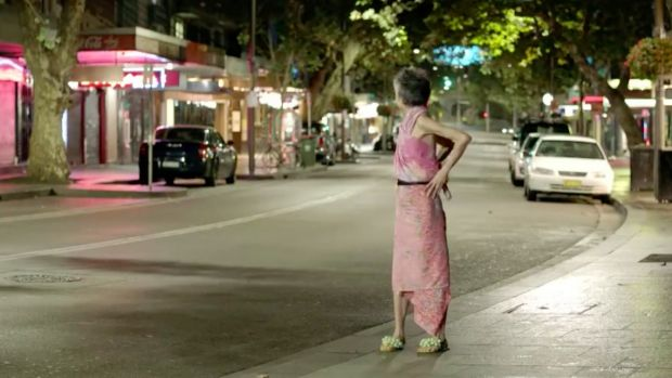 Lee Lin Chin looks back at a deserted Sydney street in a spoof attacking the lockout laws.