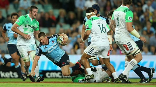 Going to ground: Paddy Ryan is brought down during the Waratahs' loss to the Highlanders.