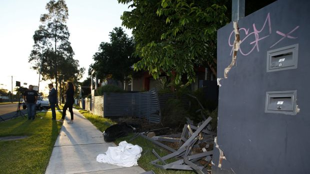 The remains of a fence that was hit by a car after a shooting in Matthew Street, Heckenberg.