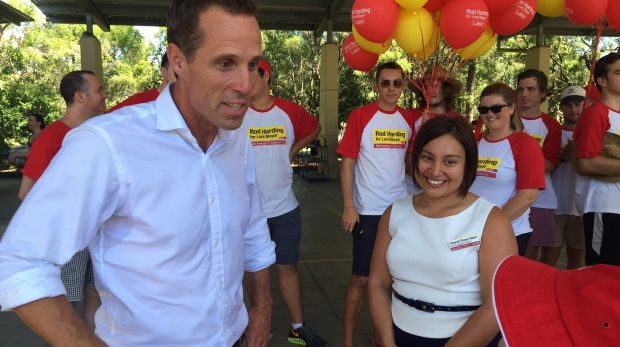 Rod Harding talks with supporters at the polling booth on Saturday morning.