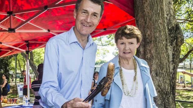 Lord Mayor Graham Quirk steps up to the sausage sizzle as he heads to the polls with his wife Anne at Warrigal Road ...
