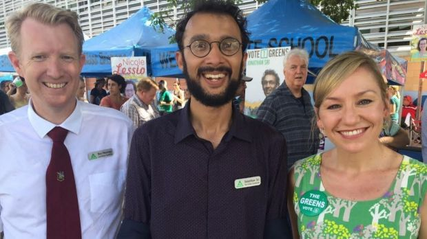 Jonathan Sri (centre, with lord mayoral candidate Ben Pennings and Senator Larissa Waters) is on track to win The Gabba.