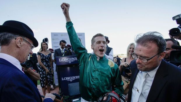 CAPITAL WIN: Jockey Blake Shinn who rode Capitalist to victory in the Longines Golden Slipper celebrates after the race ...