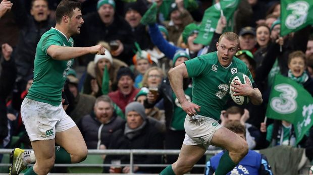Ireland's Keith Earls, right, runs,  on his way to scoring his side's second try, during the Six Nations rugby union ...