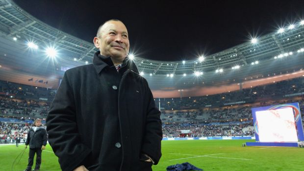 Triumphant: England coach Eddie Jones soaks up the atmosphere in France.