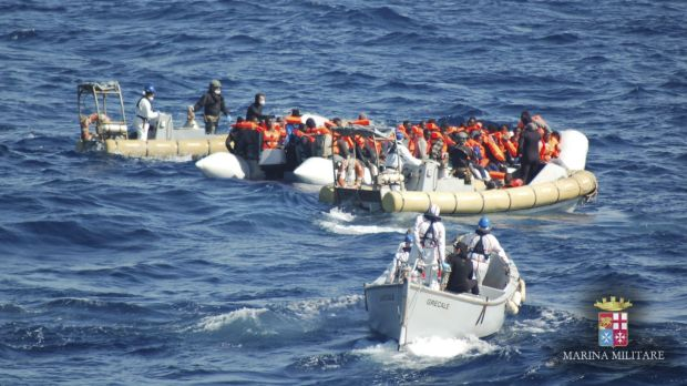 Migrants are rescued by Italian Navy personnel off the island of Lampedusa, Italy, on Wednesday.
