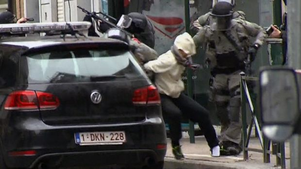 The moment Salah Abdeslam is bundled into a car by police.