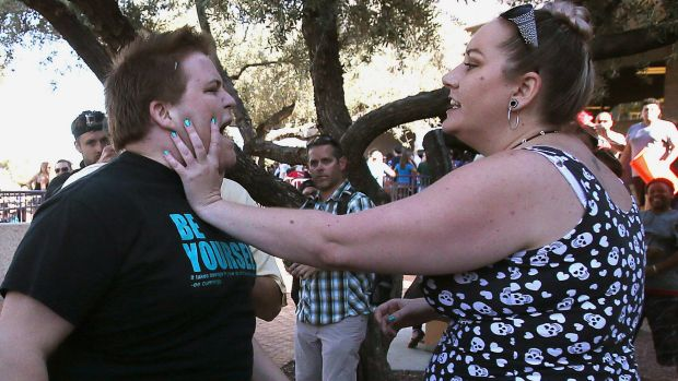 A Donald Trump protester and supporter in an altercation at the conclusion of a Trump rally at the Tucson Convention ...