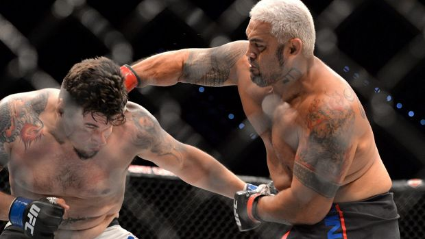 Take that:  Mark Hunt delivers the telling punch against Frank Mir during their UFC Heavyweight bout.