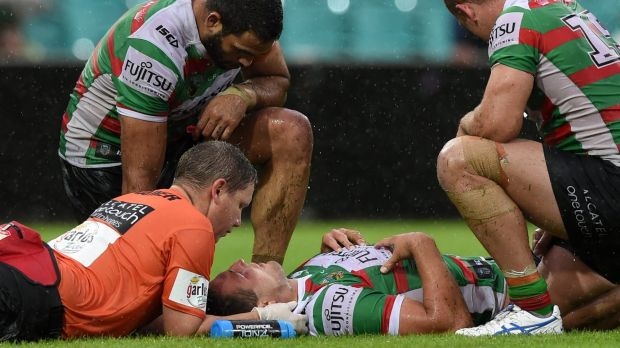 Scary scenes: Sam Burgess receives medical attention last Sunday.