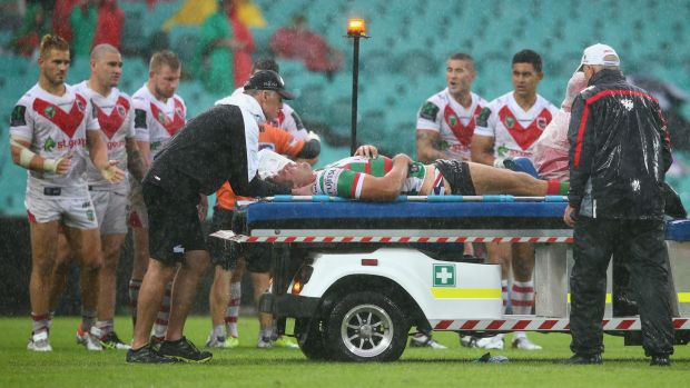 Nervous moments: Sam Burgess is taken from the field on a medicab.