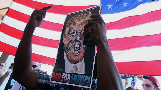 An anti-Trump sign outside the Tucson Convention Centre, Arizona, as attendees continue to file in to hear the ...