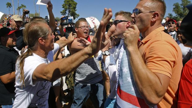 Donald Trump supporters clash with protesters at a rally in Fountain Hills, Arizona on Saturday.