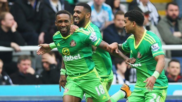 Jermain Defoe celebrates scoring for Sunderland in the Tyneside derby.