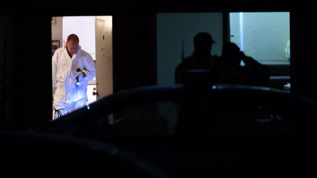 Police investigate after the body of a woman was found in  a unit.