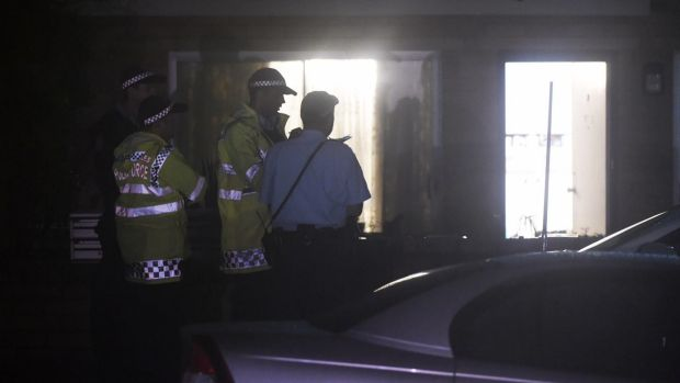 One woman is in police custody after an elderly woman was found dead in a Freshwater unit.