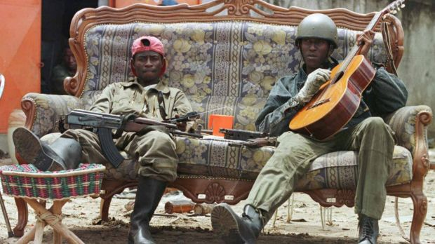 """Cobra"" rebels loyal to Denis Sassou Ngouesso man a roadblock on a street in Brazzaville, Congo in 1997."