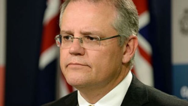 Scott Morrison said the national interest test would remain on any move to buy more than 15 per cent of the ASX.