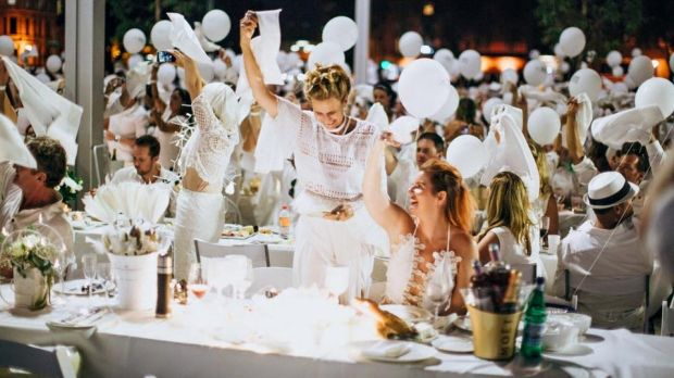 The waving of the napkins signified the start of Diner en Blanc in Perth.