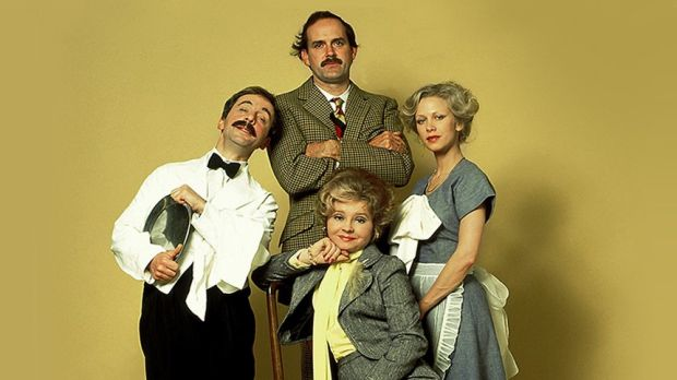 The cast of the original <i>Fawlty Towers</i>: (From left) Andrew Sachs as Manuel; John Cleese as Basil, Prunella Scales ...