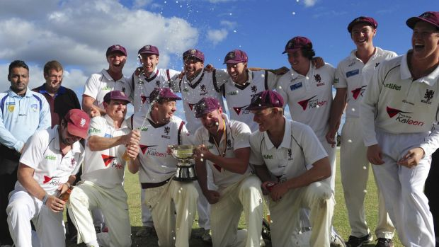 Winners of the Douglas Cup grand final at Chisholm Oval, Wests/UC, celebrate their win against Weston Creek/Molonglo.