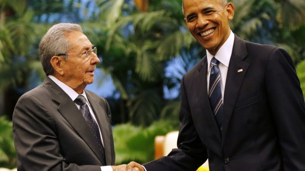 Cuban President Raul Castro, left, shakes hands with US President Barack Obama during a meeting in Revolution Palace on ...
