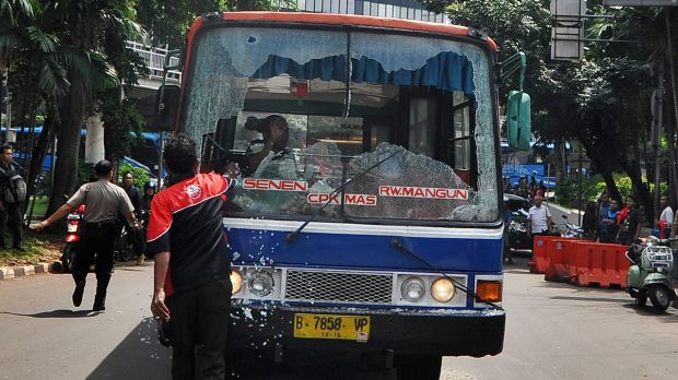 A bus windshield destroyed during mass strikes against public transport apps in Jakarta.