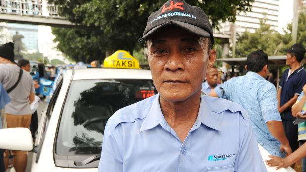 Tarwo, an Indonesian taxi driver, says the advent of Uber has left him having to borrow money from his employer to stay ...