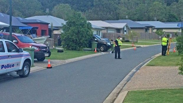 Police on the scene where an 18-month-old boy was struck by a car and killed.