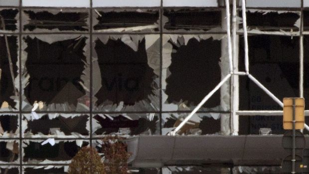 Shattered windows at Zaventem airport in Brussels after a bomb blast on Tuesday.