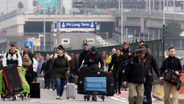 Passengers are evacuated from Zaventem Bruxelles International Airport after a terrorist attack on March 22 in Brussels.