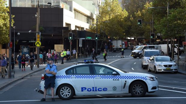 NSW Police block Darlinghurst road as Greenpeace protestors sit atop the Coca-Cola sign in Kings Cross.