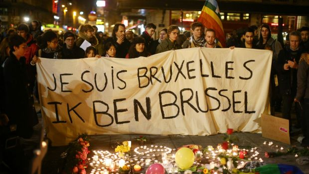 I am Brussels, the banner reads, as members of the public pour onto the streets to protest against the bombings on ...