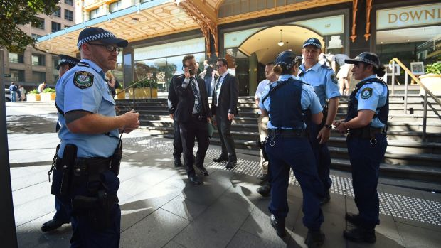 NSW police outside the Downing Centre court complex after a man was arrested on Wednesday morning.