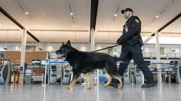 A police officer patrols the Pierre Elliott Trudeau International Airport in Montreal, Canada, on Tuesday after the ...