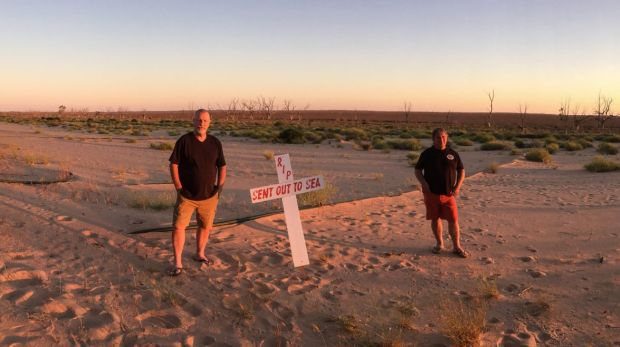 Darryn Clifton (left) and Ross Leddra on the shore of Lake Menindee, now the site of bores to supply Broken Hill with ...