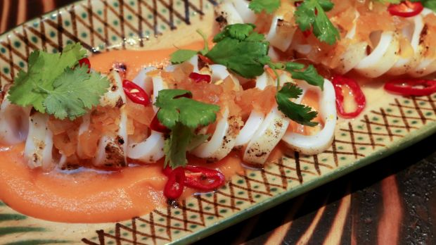 Grilled whole calamari with coriander, red chilli and escabeche sauce.
