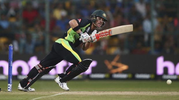 Back foot: David Warner clips a shot through mid-wicket against Bangladesh.