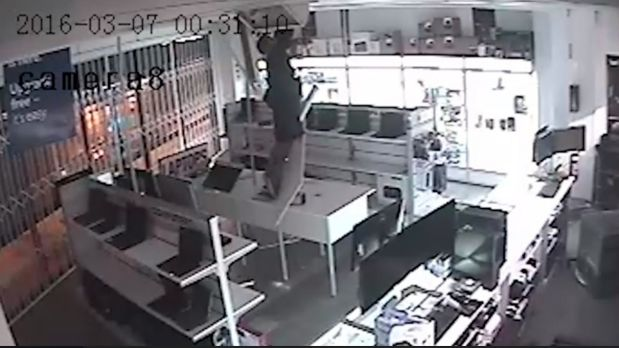 A man lowered himself down through the ceiling of a Chermside computer business in an attempted burglary.