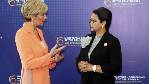 Indonesia Foreign Minister Retno Marsudi, right, listens to Julie Bishop during the Bali Process regional ministerial ...