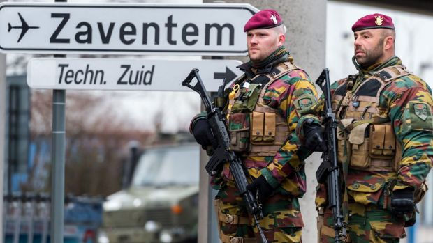 Belgian soldiers patrol at Zaventem Airport in Brussels on Wednesday last week after dozens were killed in bombings at ...
