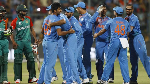 One for the books: Indian players celebrate their remarkable win against Bangladesh.