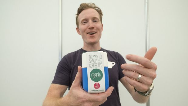 Saxon Wright, founder of Pablo & Rusty's Coffee Roasters, shows off his Frank Green cup at the Coffee expo at the ...