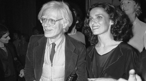 With artist Andy Warhol at a party in 1978.