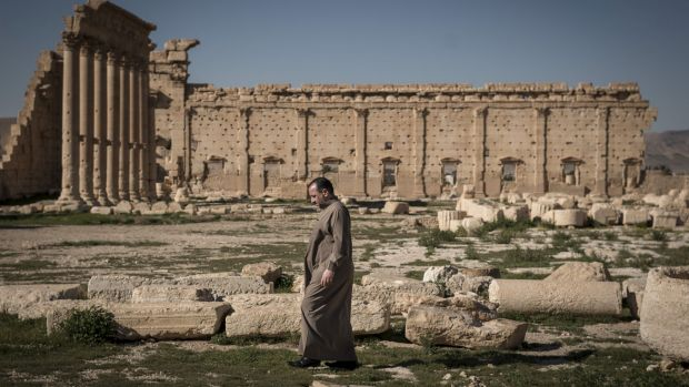 A man walks through the ruins of the Temple of Bel in Palmyra, Syria, in 2014,