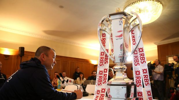 Silverware: England coach Eddie Jones alongside the Six Nations trophy.