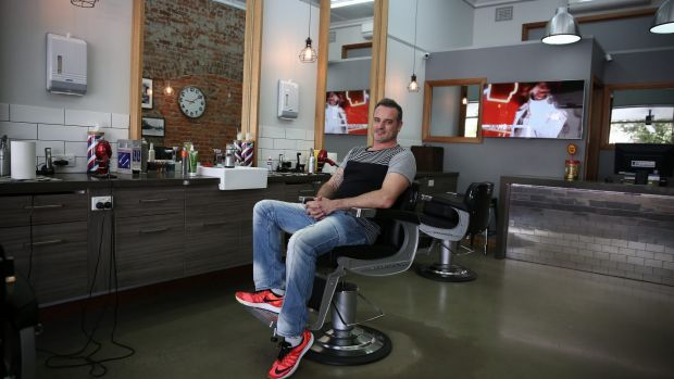 """Barber shop owner David Tutalo: """"It's just another day, you've got to vote."""""""