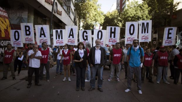 Demonstrators protest against the visit by President Barack Obama, near the US Embassy in Buenos Aires. Human rights ...